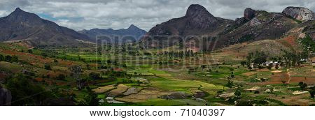 Green valley with rice fields and villages among mountains. Anja reserve, Madagascar