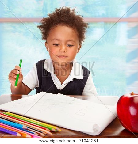 Portrait of cute little African preschooler on drawing lesson, have big fresh red apple for lunch in the school, elementary education concept