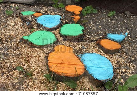 Coloured stubs with grass and sawdusts on a ground in a dacha garden