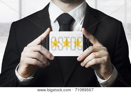 Businessman Holding Sign Three Golden Rating Stars