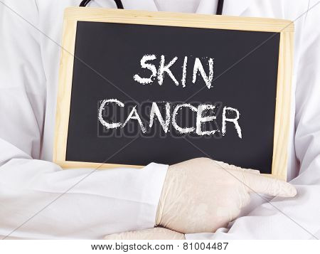 Doctor Shows Information On Blackboard: Skin Cancer