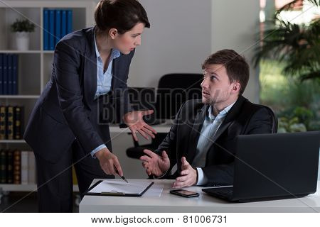Horizontal view of boss yelling at employee poster