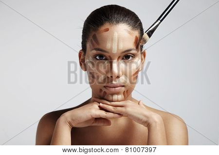 facial contouring. Woman with different shades of foundation on her face poster