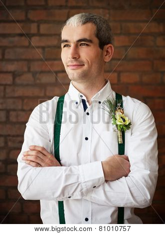 Groom Wearing Buttonhole With White Anemone