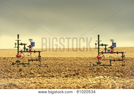 Two Wellheads From Gas Wells