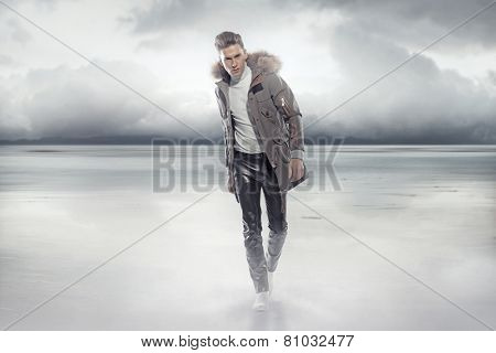 Fashionable man wearing winter jacket