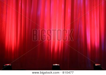 Spot lights on red curtain