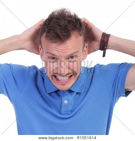 picture of a young casual man with an exasperated expression. isolated on a white background