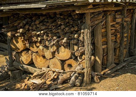 Firewood logs / Firewood in a pile mountain village ,Thailand