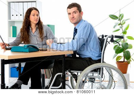 Man In Wheelchair And His  Is Female Colleague Working In The Job