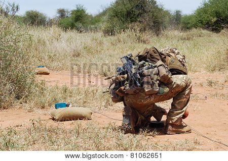 British Army Bomb Disposal Expert laying an explosive charge. poster