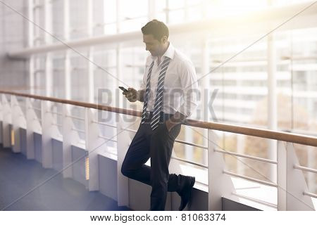 Businessman With Open Collar And Tie Undone