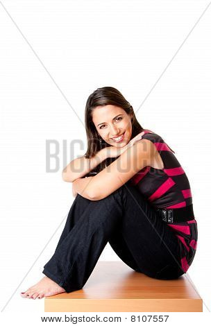 Happy Woman Sitting On Wood
