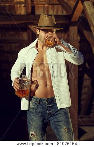 Sexy Macho Cowboy Drink Whiskey In Barn