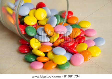 Colorful sugar-coated chocolate smarties in a glass