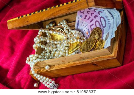 gold coins and bars with decorations on red velvet. photo icon for wealth, luxury, wealth tax