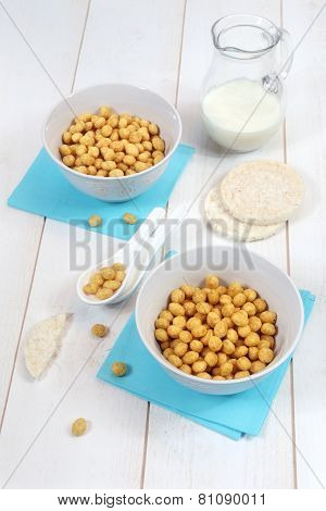 Corn Flakes In Bowl And  Milk On A White Background