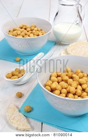 ?orn Flakes In Bowl And  Milk On A White Background