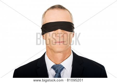 Mature businessman with band on eyes.