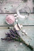 Spa and wellness setting with lavender flowers floral water and bath salt. Dayspa nature set poster