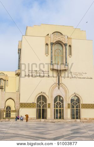 CASABLANCA, MOROCCO, APRIL 2, 2015:  Local people rest in front of the Museum of Hassan II Mosque or Grande Mosquee Hassan II