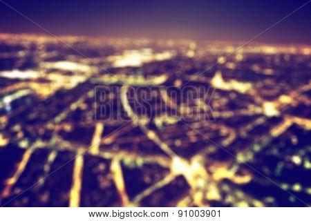 Big city night lights bokeh, blurred background. Vintage style, nightlife blur