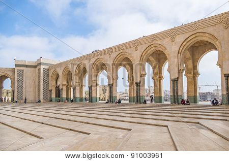CASABLANCA, MOROCCO, APRIL 2, 2015: People gather on the outside grounds of Hassan II Mosque or Grande Mosquee Hassan II