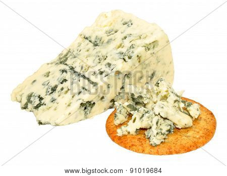 Danish blue veined cheese wedge with cheese biscuits isolated on a white background poster