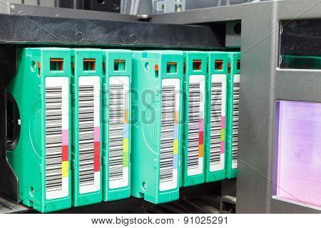 streamer, tape library for data backup in the server rack in the datacenter poster