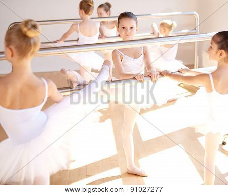 Young Girls In Ballet School Training At The Bar