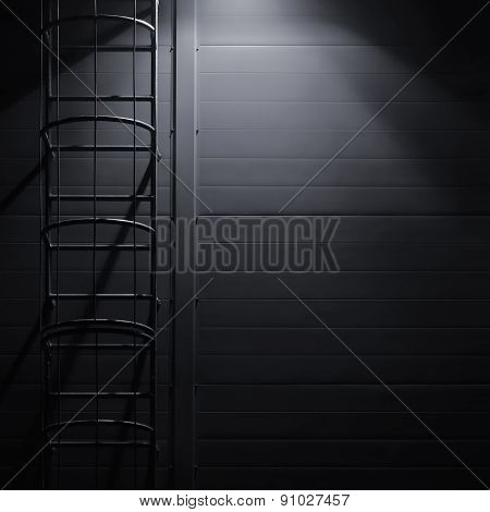 Fire emergency rescue access escape ladder stairway, roof maintenance stairs at night, bright shining lantern lamp light illumination glow shadows, rustic textured industrial building wall panels texture pattern, large detailed vertical closeup copy space poster