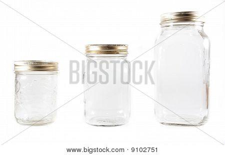 Three Glass Mason Jars On An Isolated Background
