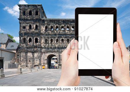 Tourist Photographs Porta Nigra In Trier, Germany