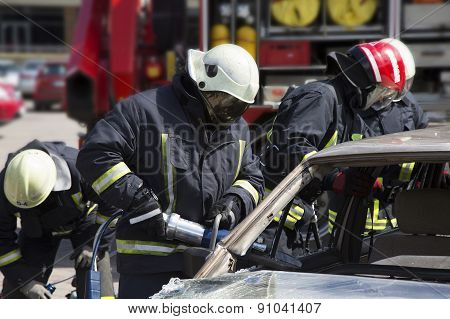 Firefighters With The Pneumatic Shears Open The Car Doors