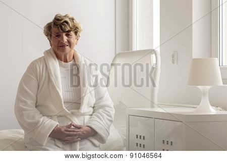 Woman Wearing Bathrobe In Hospital
