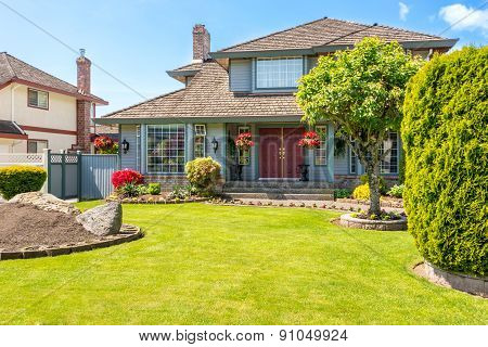 Entrance of a luxury house with a patio on a bright, sunny day. Home exterior. poster