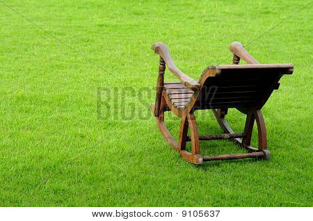 Chair in green meadow , grass