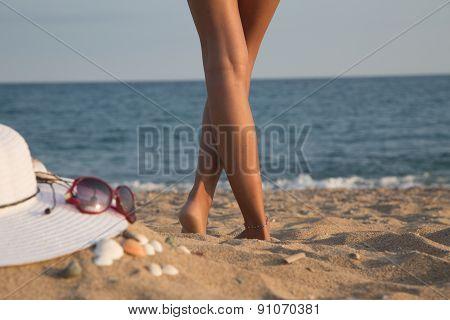 Legs Of A Girl On A Beach