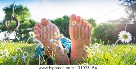 Children's feet in the grass
