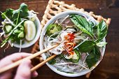 vietnamese pho with spicy sriracha sauce shot top down poster