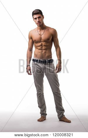 Handsome shirtless athletic young man on white