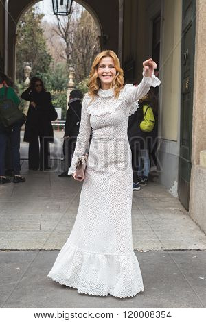 MILAN ITALY - FEBRUARY 25: Fashionable woman poses outside Luisa Beccaria fashion show building for Milan Women's Fashion Week on FEBRUARY 25, 2016 in Milan.
