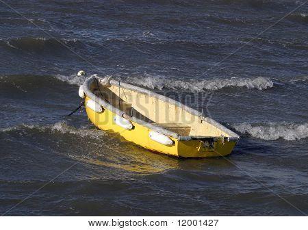 Small boat moored in choppy seas