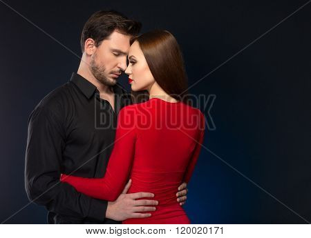Pleasant loving couple bonding to each other