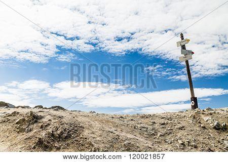 Trail Sign On High Inspiring Mountain Pass