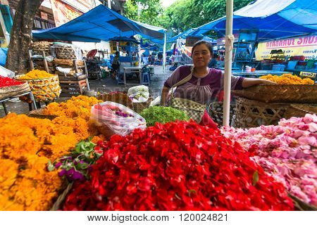 GIANYAR, INDONESIA - FEB 28, 2016: Unidentified local street vendor. Since the beginning of the XXI century the Bali's population increased by more than a million people, now more than 4,2 million.