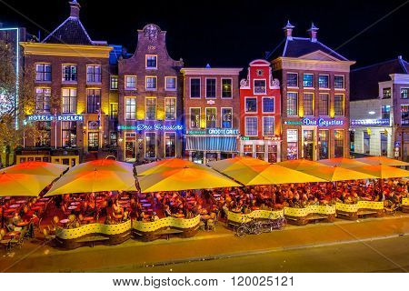 GRONINGEN THE NETHERLANDS-MAY 5, 2015: Students on teracces in the night. Famous bars and restaurants in the old center of the university town of Groningen. The Grote Markt is famous for its nightlife for students