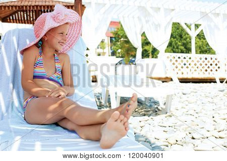 Luxury Resort Little Girl Relaxing . Caucasian Cute Child Lying Down On Deckchair Of Beach Resort Fo