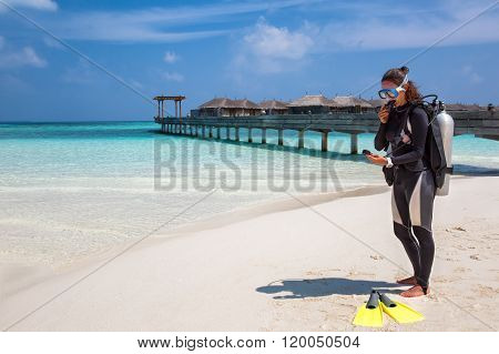 Female scuba diver checking her equipment