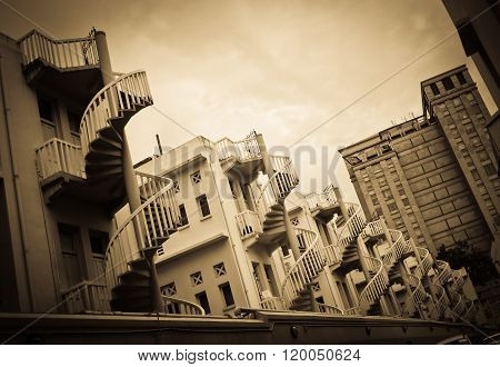 Spiral staircases at the back of traditional Chinese shop houses in Bugis Village Singapore. poster